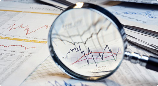 Technical Analysis in depth analysis showing magnifying glass on top of forex charts